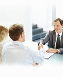 A couple talking and shaking hands with their insurance adjuster in Los Angeles